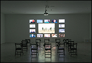 AGNÈS VARDA. Les Veuves de Noirmoutier [The Widows of Noirmoutier], 2005. Installation, projected film, 9'30'' with sound, 14 videos, 3'30'', 14. Chairs and Headphones, 3,4 x 7,5 m. Music by Ami Flammer